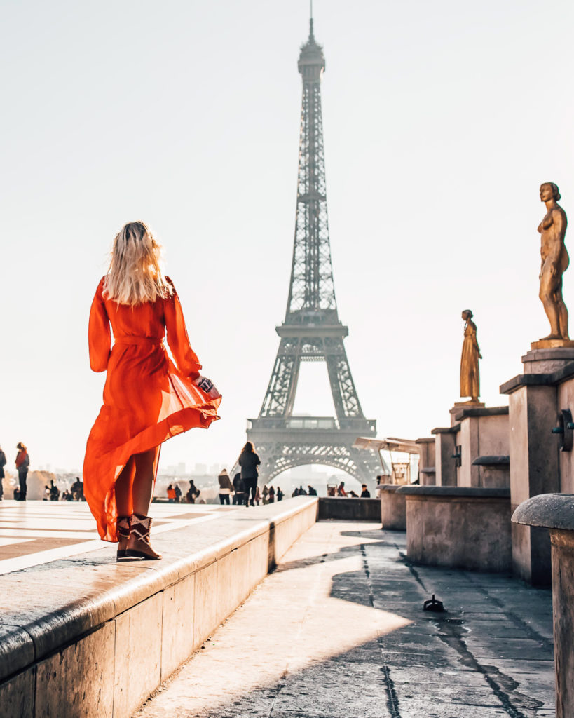 Girl in red dress and vintage kilim rug boots in Paris