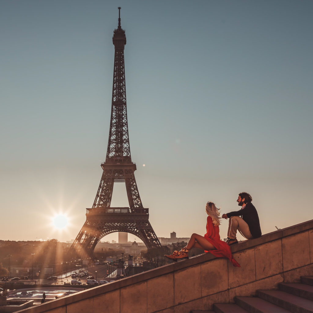Eiffel Tower and a couple enjoy the views in their leather boots